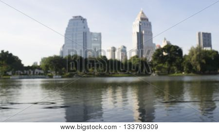 Defocus and blur image of terrace lake water trees and building in the city. Park view in the city. Concept of nature in the city in background