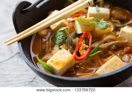 Asian soup bowl with tofu and mushrooms
