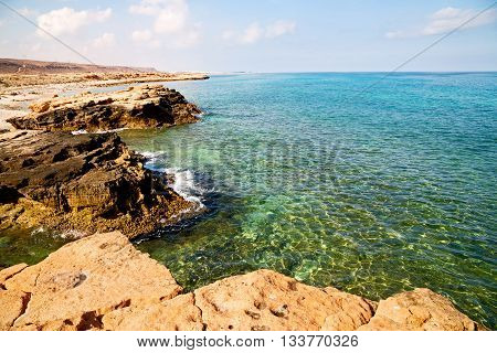 In Oman Coastline Sea Ocean Gulf Rock And Beach Relax Near Sky