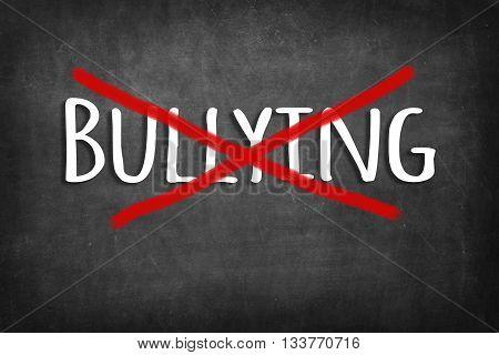 (stop) bullying chalk word on black blackboard background