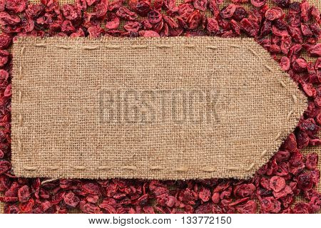 Pointer of burlap lying on a dry cranberry background with place for your text