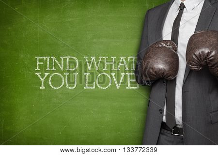 Find what you love on blackboard with businessman wearing boxing gloves