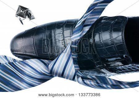 Close-up blue shoes and blue tie isolated on white background