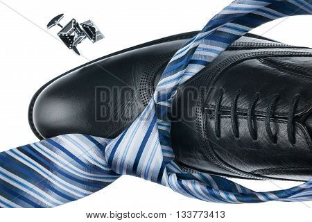 Close-up black shoes and blue tie isolated on white background