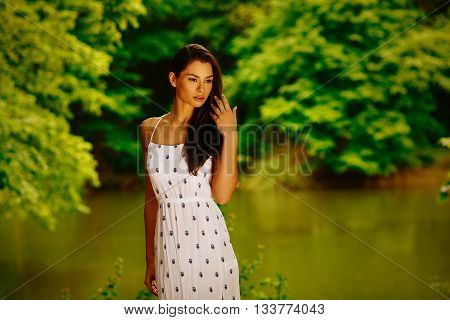 Beauty portrait of young women in the woods by the lake