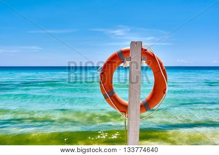 Orange Life preserver hang on the pole