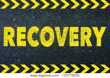 recovery sign yellow word on road background