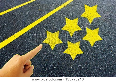 hand pointing five stars rating on road