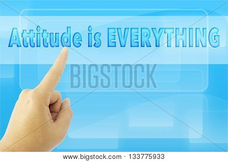 touching ATTITUDE IS EVERYTHING sign on blue screen