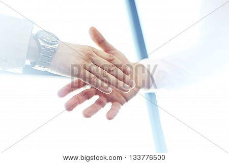 Business partnership meeting concept. Image businessmans handshake. Blurred, sunlights