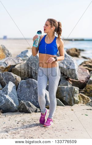 Woman Working Out Outdoors In The Summer At The Beach