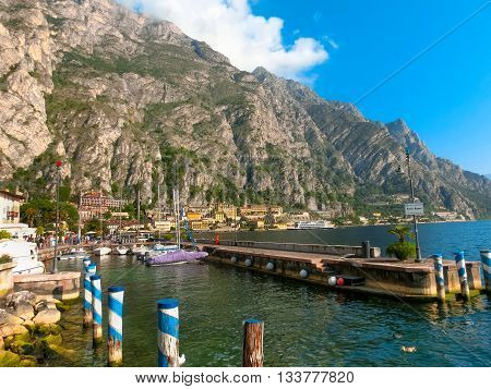 Limone sul Garda, Italy - September 21, 2014: The famous Village of Limone sul Garda on Lake Garda, Italy. The boardwalk with houses and boats