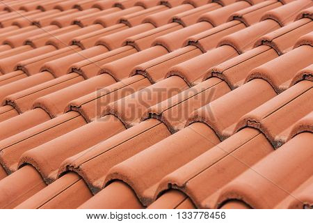 Close-up of roof tiles. Red roof texture.