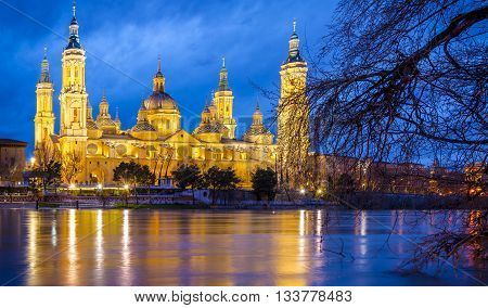 Pilar Basilica by night on the banks of the Ebro. Zaragoza, Spain