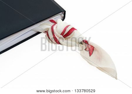 Handkerchief knot inside personal diary as bookmark  on white background