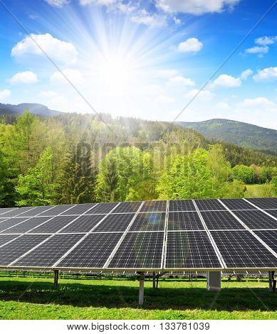 Solar panels in spring landscape. Clean energy.