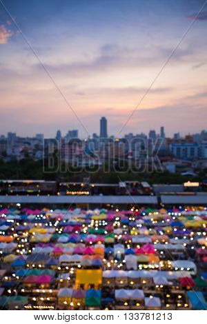 Abstract blurred light aerial view multiple colure night market and city downtown background night view
