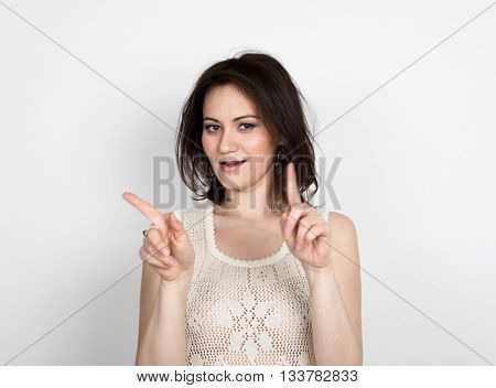 beautiful young brunette woman in a lace dress posing and expresses different emotions. woman's hands shows various signs. close-up portret.