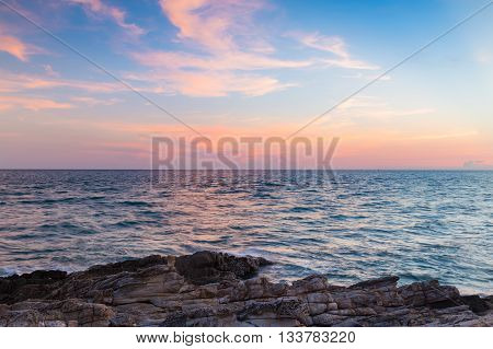 Beautiful natural landscape background, sky and clouds over seacoast after sunset