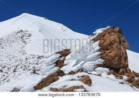 Snow-covered rock on the volcano erdzheyas. Turkey