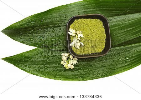 Spa mud flower and green leaf on white background