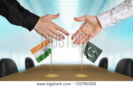 India and Pakistan diplomats shaking hands to agree deal, part 3D rendering