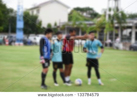 blurry,Coach goalkeeper in action training football,defend (soccer)