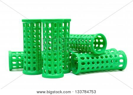 Green curlers isolated on a white background