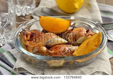 Baked in the oven chicken with orange garlic and onion