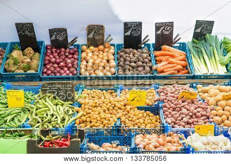 Fresh vegetables on vegetables market in Amsterdam Netherland. Many vegetables in basket for sell. Vegetables retail in Amsterdam Netherland