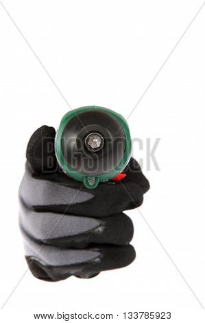 Cordless screwdriver in hand in a protective glove isolated on white background.