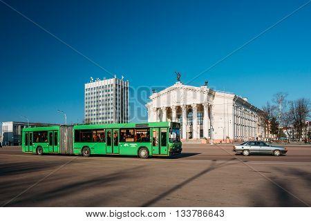 Bus Moving Along Street Near Building Of Gomel Regional Drama Th