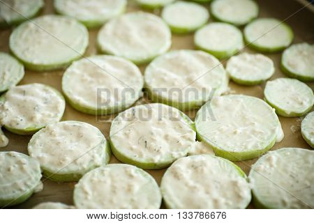 raw zucchini sauce on baking paper in a baking