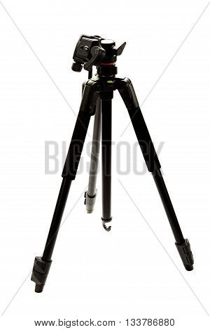 Modern photo and video tripod isolated on white background.