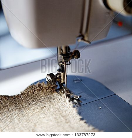 Sewing machine working part with the cloth.