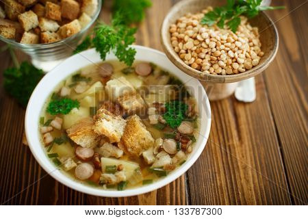 pea soup with croutons on the table