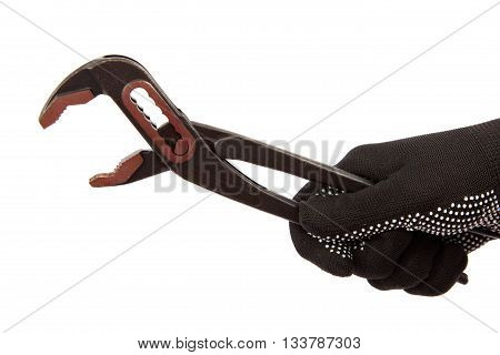 Adjustable spanner in hand with glove isolated on white background.