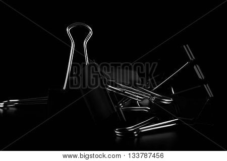 A typical paper clips on black background