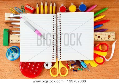 Office and student accessories on wooden background. Back to school concept.