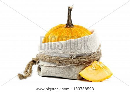 Pumpkin on sackcloth isolated over white background.