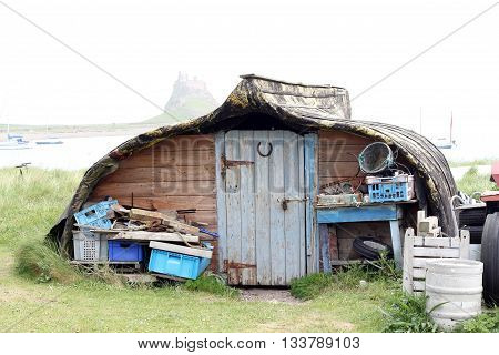 Quirky shed, tiny house, boat converted into a storage shed on the island Of Lindisfarne
