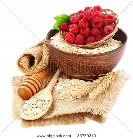 Fresh raspberry and Oatmeal flakes isolated on white background. Healthy food.