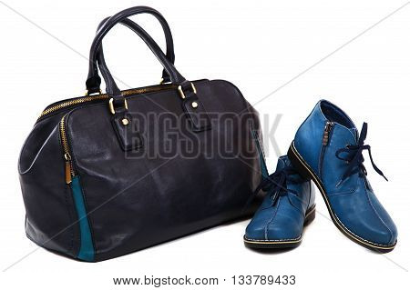 Modern women's fashion footwear and bag isolated against white background.