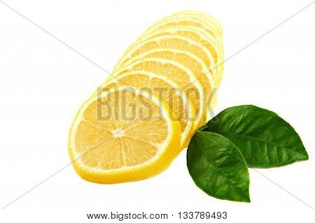 Fresh sliced lemon and green leaves isolated on white background.