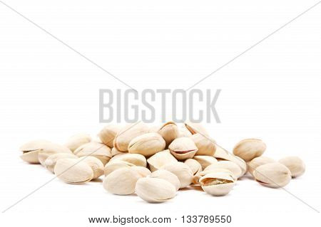 Pistachios heap isolated against a white background.