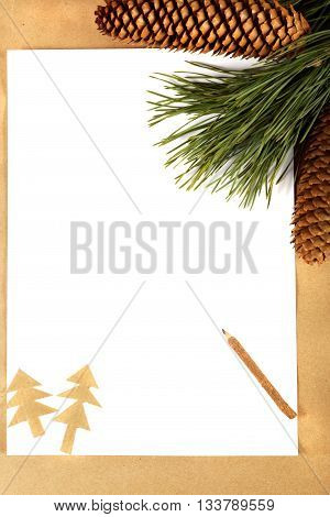 Pine branch with cones paper and pencil. Concept congratulations on Christmas.