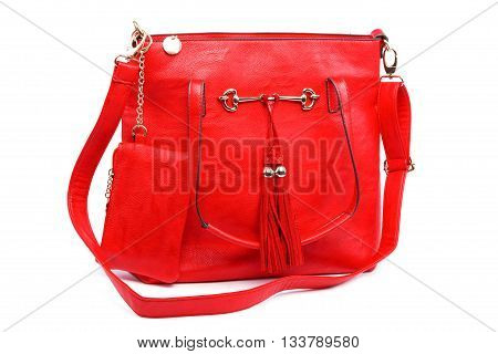 Red modern fashionable leather female bag isolated on white background.