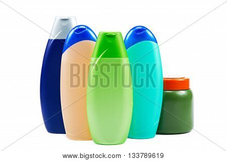 Different color tubes and bottles for hygiene health and beauty on a white background.