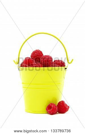 Raspberries in a bucket isolated on a white background.
