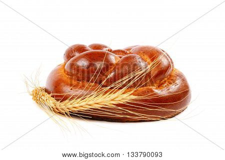 Bread loaf and wheat ear isolated on a white background.